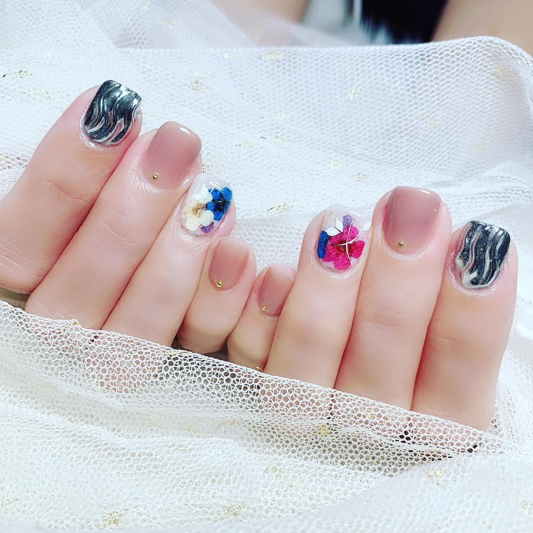 Mix and match floral patterns at Tiff's Nails