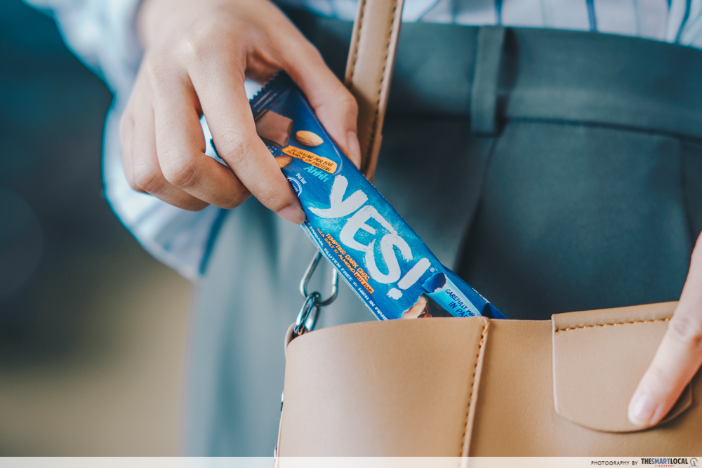 nestle yes bar - keeping snack bar into bag