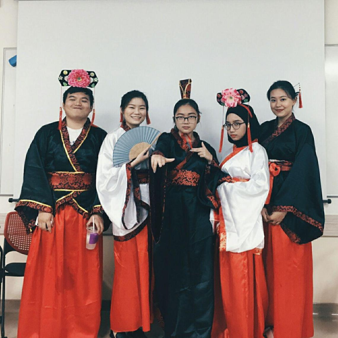 traditional Malay family - role playing as empress for NUS history module