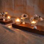 Centro-escultura de mesa con madera acero semillas, perlas y tejidos naturales