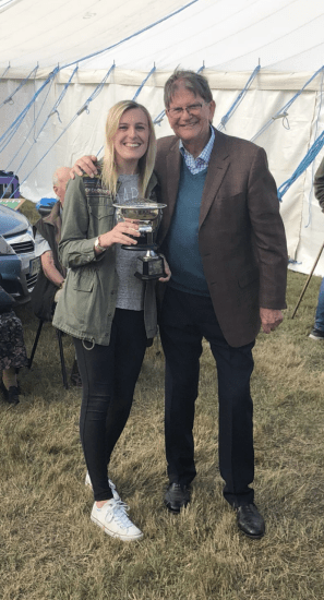 young female holding horticultural cookery cup