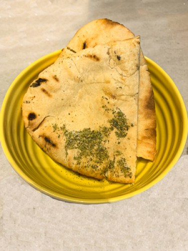 pitta bread garnished with herbs