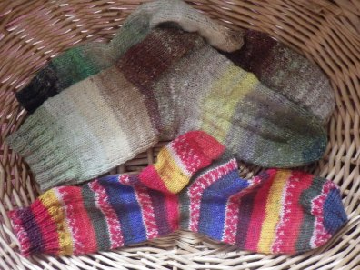 One less-than subtle sock with the completed Noro pair