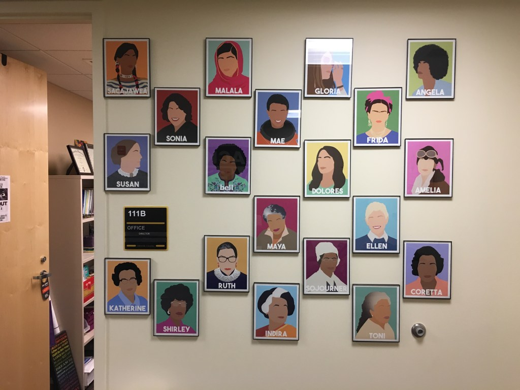 The outside wall of Jasmine Whitlow's office is decorated with influential women throughout history like Ruth Bader Ginsburg, Malala Yousafzai and Katherine Johnson.