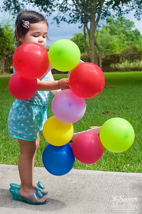 Celebrate a milestone birthday with adorable two year old photos! This fun and colorful balloon themed photography shoot is super easy to create.
