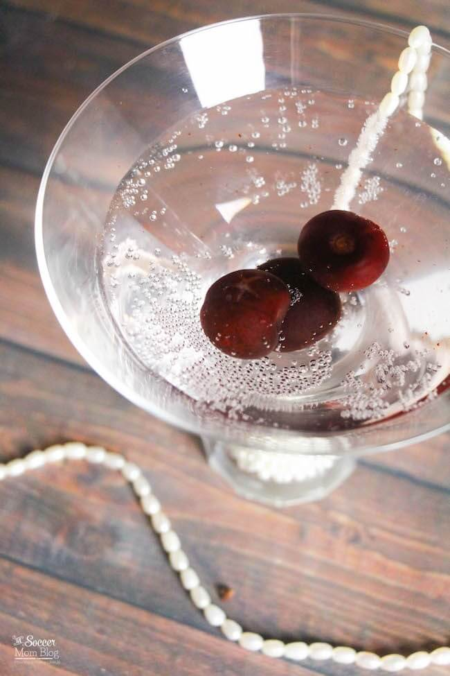 Gorgeous and sophisticated, this Sparkling Black Cherry Martini cocktail recipe is perfect for New Years, Valentine's, or a Great Gatsby themed party.