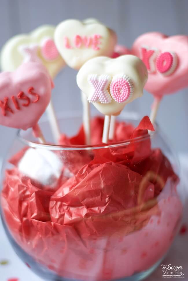 An adorably sweet Valentine's Day treat! Conversation Heart Marshmallow Pops are a fun kids activity and the perfect gift for friends, family, and teachers!