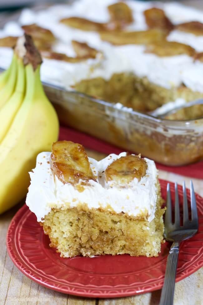 Brown Sugar Banana Pudding Poke Cake is TRIPLE banana goodness! Real banana baked into the batter, topped w/ homemade banana custard & caramelized bananas.