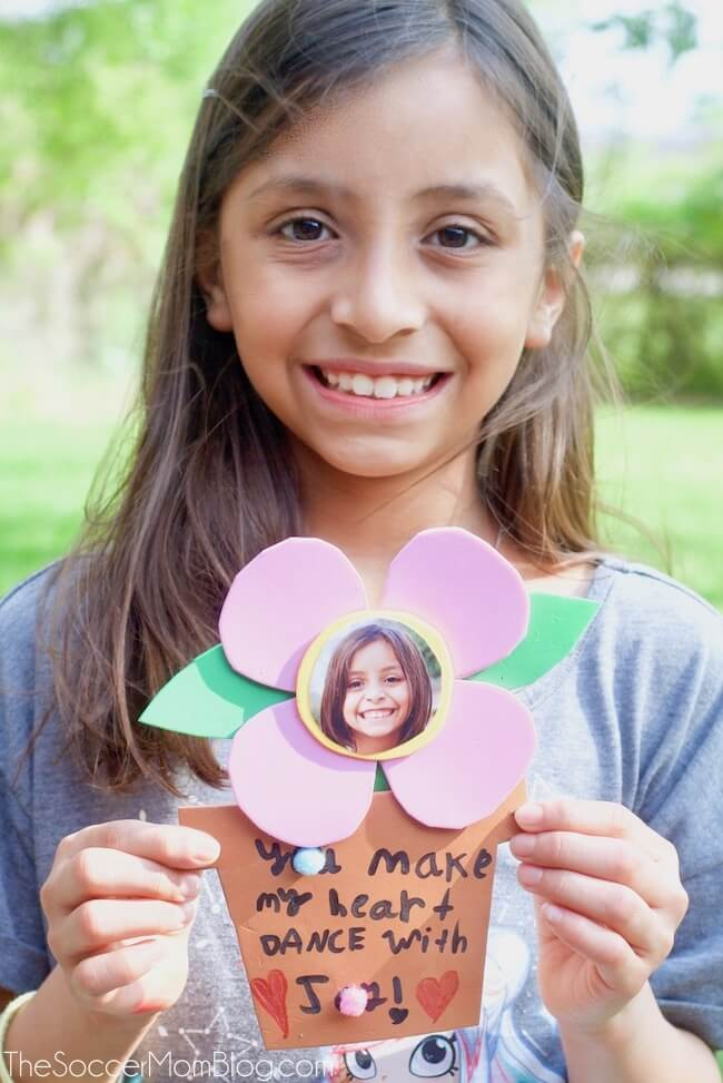A sweet kid-made photo flower craft just for mom on her special day!Whether you're looking for a fun spring kid craft or a Mother's Day card idea, these dancing foam flowers are perfect! Easy to make with simple supplies!
