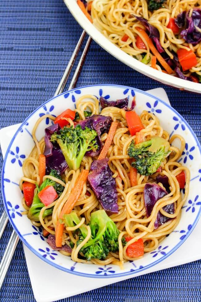 Skip the takeout!! This Easy Vegetable Lo Mein recipe is faster and healthier! Ready in 15 minutes or less, this vegetarian dish is bursting with flavor and vibrant colors. Add your favorite protein to make it an even heartier meal!