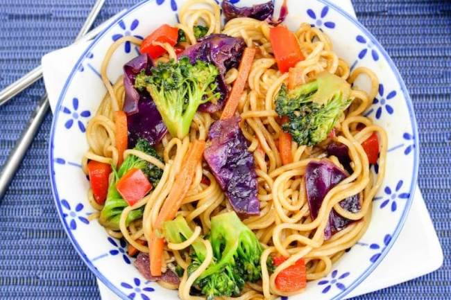 Easy lo mein recipe on plate with blue background