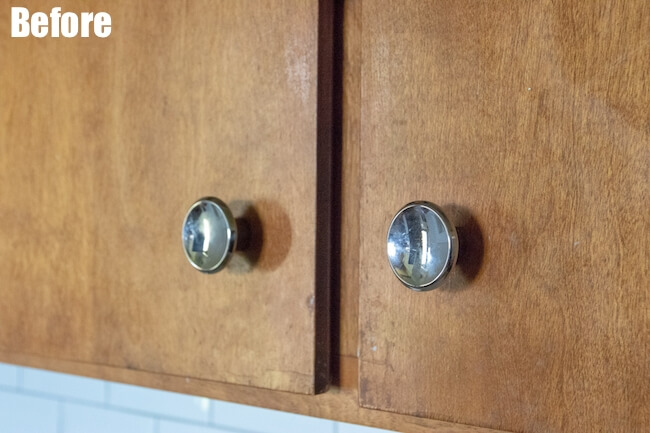 Wooden kitchen cabinets with old knobs