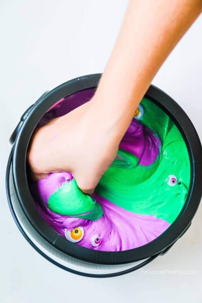 Creepy cool!! This witches brew Halloween slime is super stretchy fluffy slime filled with monster eyes.