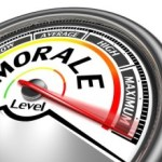 What contributes to decreased employee morale?