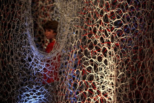Branching Morphogenesis, a walk-through installation by Jenny Sabin, consisting of 75,000 cable ties combined in a beautiful 3D network, somehow resembling neural net of the brain. Credit