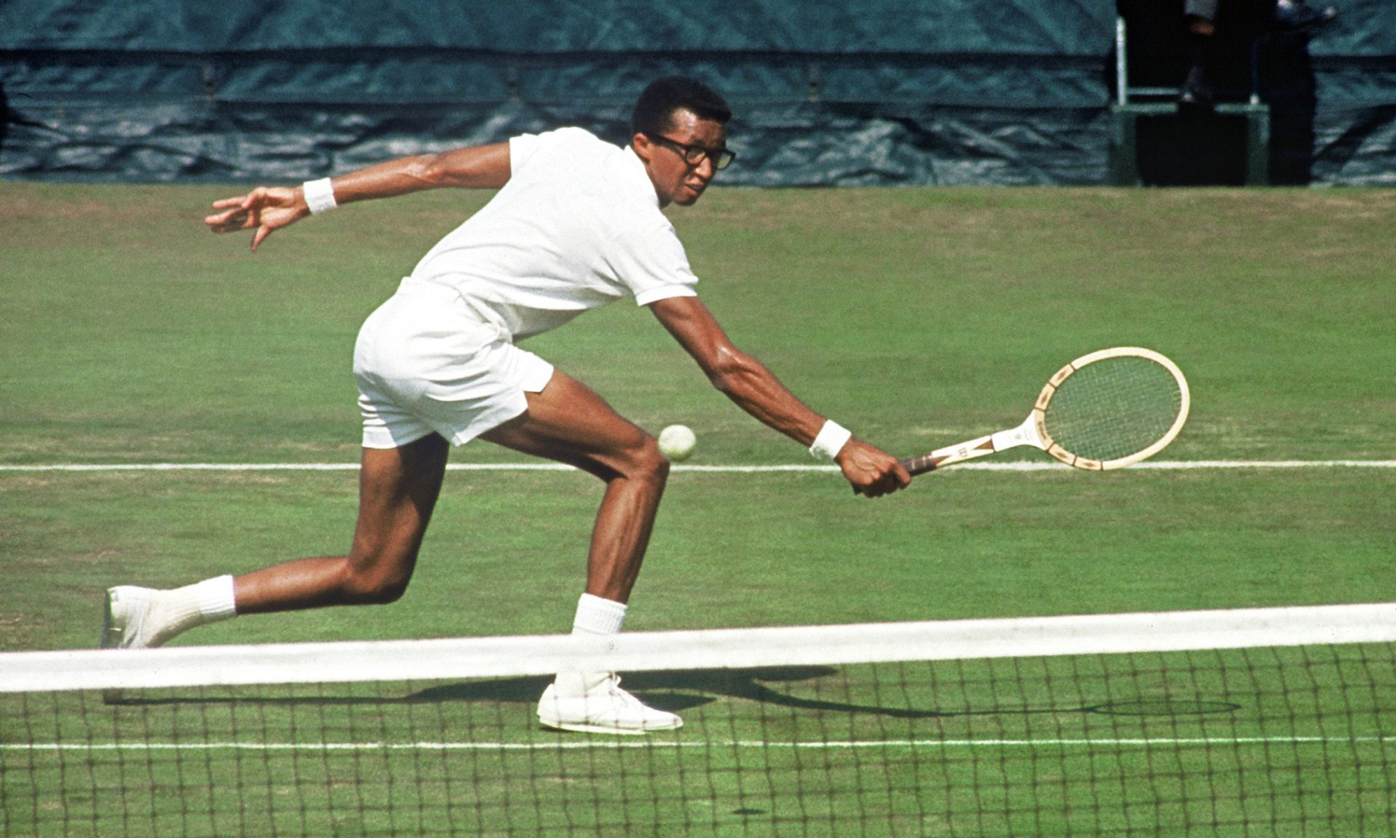 Arthur Ashe reaches for a backhand