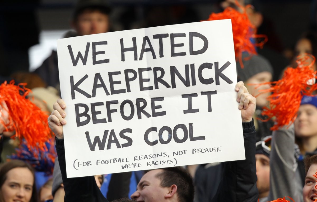 "Fan with a sign that reads, ""we hated Kaepernick before it was cool (fot football reasons, not because we're racists)"""