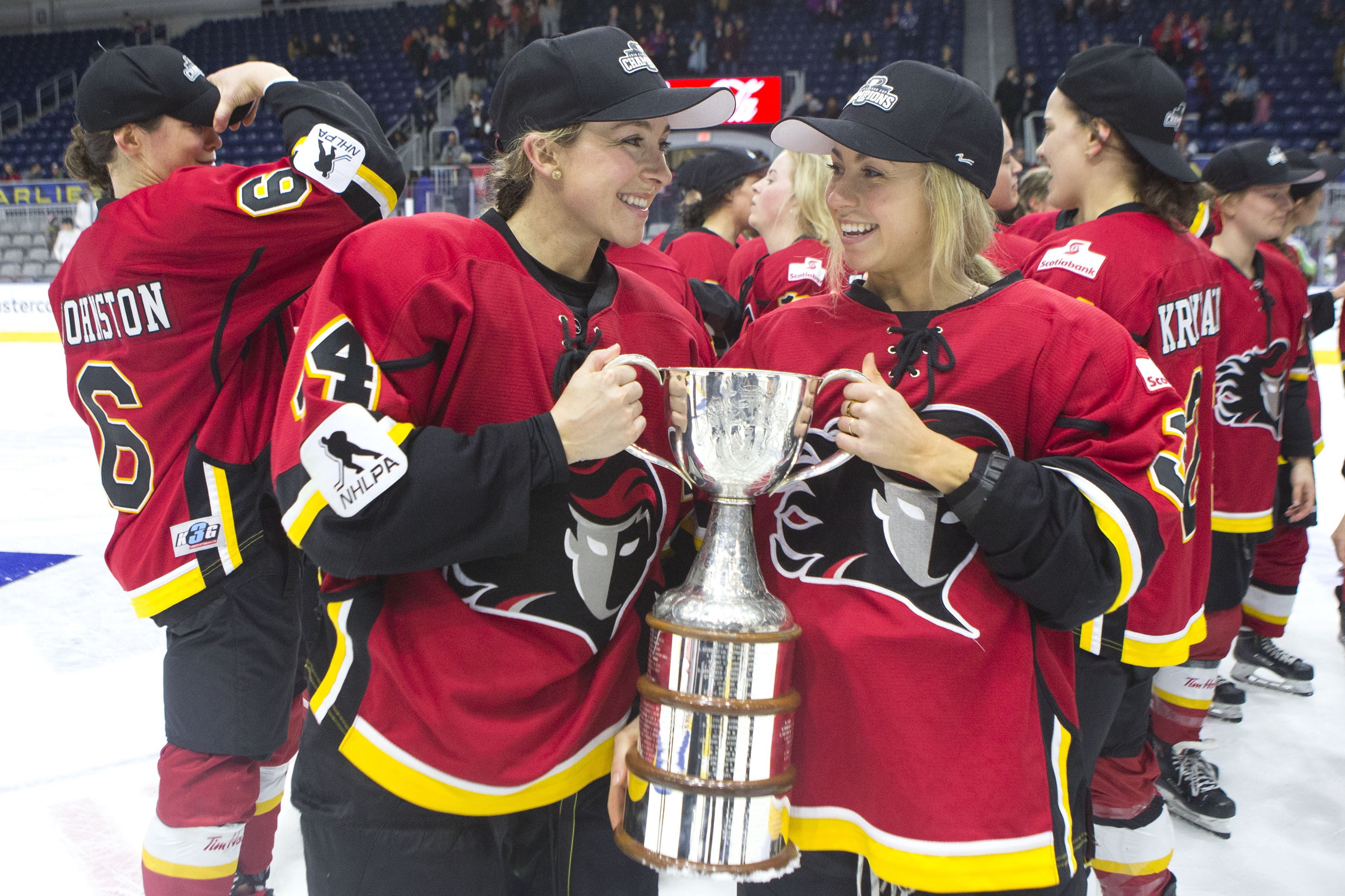 Calgary Inferno's Zoe Hickel (L) and Tori Hickel celebrate winning the 2019 Canadian Women's Hockey League Clarkson Cup after beating Les Canadiennes de Montreal.