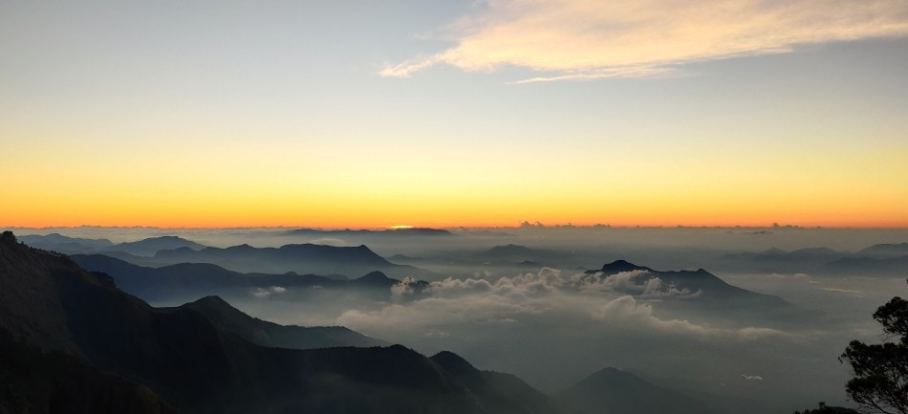 Sunrise over a bed of clouds