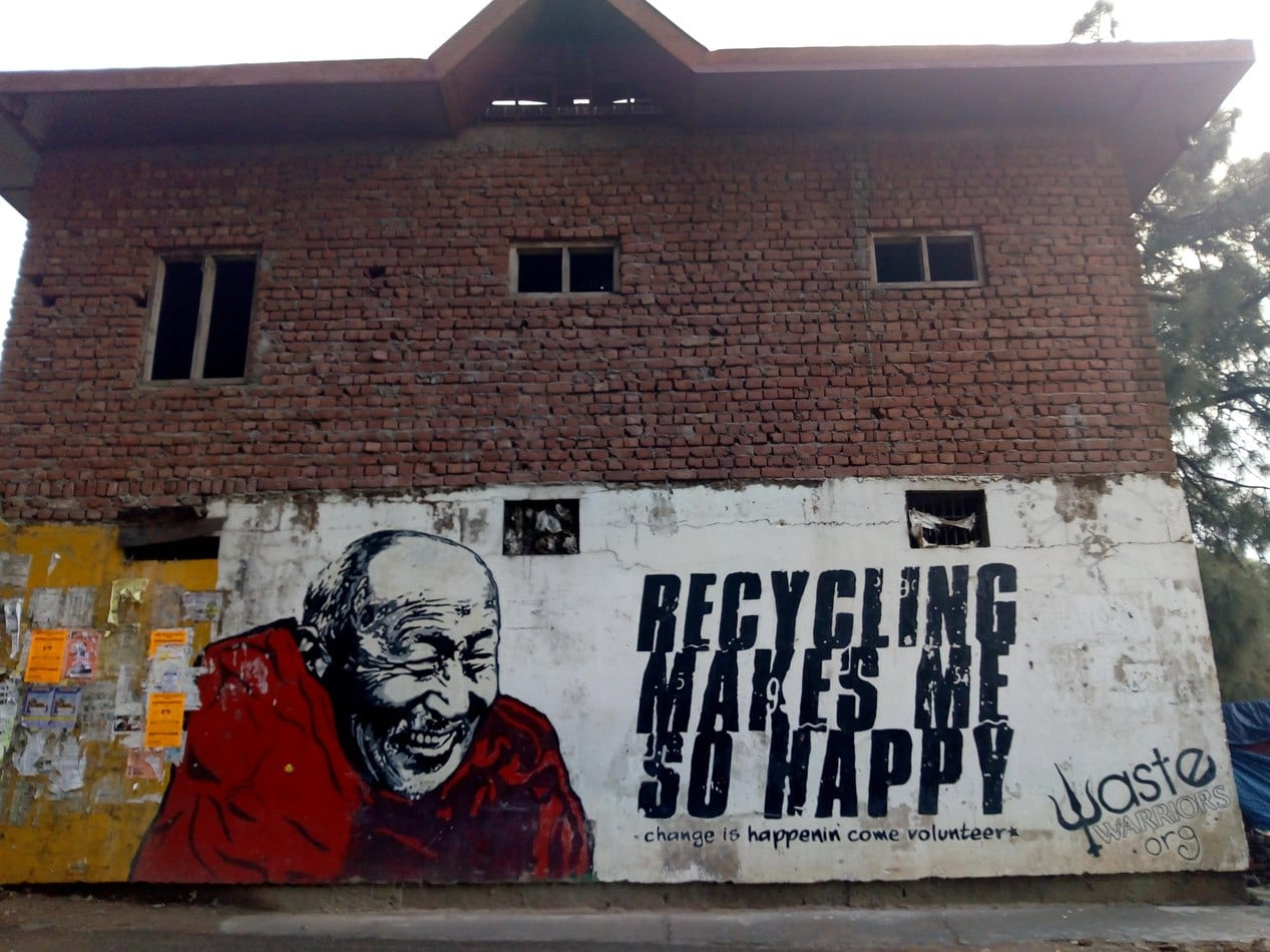 Dalai Lama wall painting with recycling message