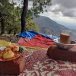 Tea and Momos with mountains in background