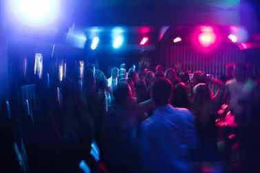 people dancing inside building