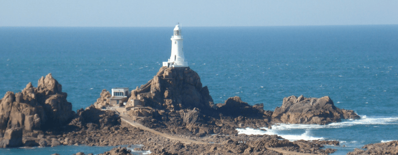 Corbiere lighthouse in Jersey on a sunny day. Photo quote: lighthouses don't go running all over an island looking for boats to save, they just stand there shining.