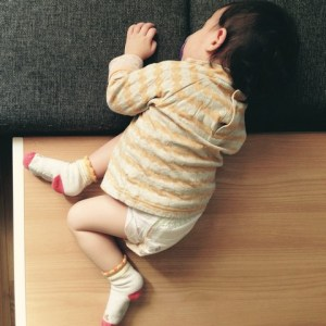 baby sleeping on a table
