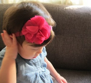 baby with pink flower headband