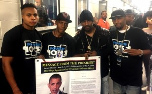 """Sharieff """"The Fitness Sheriff,"""" C. Fisher, DJ Clue? and R. Fisher holding Presidential Message from Obama."""