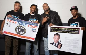 """Sharieff """"The Fitness Sheriff,"""" R. Fisher, DJ Suss-One and C. Fisher holding Presidential Message from Obama and the HAGGV Banner."""