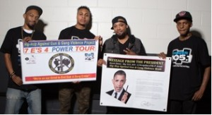 """R. Fisher, Sharieff """"The Fitness Sheriff,"""" Jovonn and C. Fisher holding Presidential Message from Obama and the HAGGV Banner."""
