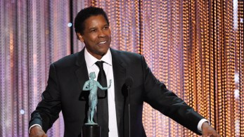 """Denzel Washington accepts the award for outstanding performance by a male actor in a leading role for """"Fences"""" at the 23rd annual Screen Actors Guild Awards at the Shrine Auditorium & Expo Hall on Sunday, Jan. 29, 2017, in Los Angeles. (Photo by Chris Pizzello/Invision/AP)"""