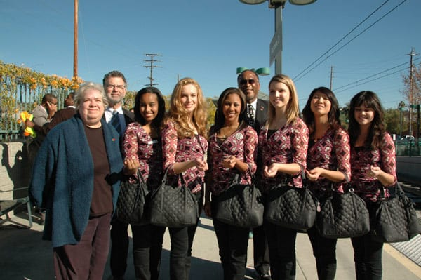 From left, Metro Board Member Pam O'Connor, Metrolink Board Chairman Richard Katz and Metro Operations Chief Lonnie Mitchell join Rose Queen Drew Helen Washington and Royal Court at Heritage Square Station.