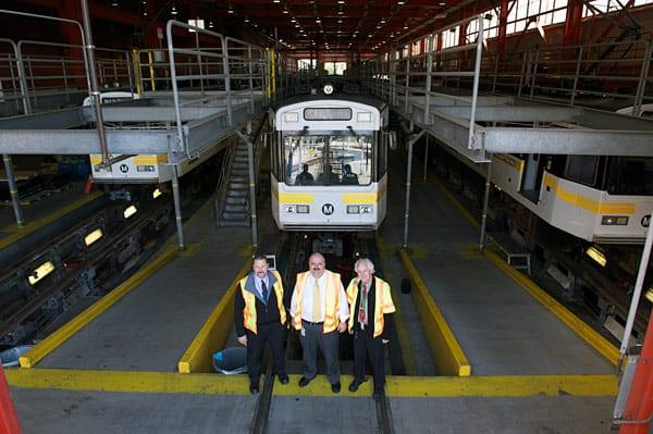 Rail Fleet Services team oversee a comprehensive rail car overhaul at Metro Blue Line maintenance facility. From left, Brian Rydell, Nick Madanat, Russell Homan. Photos by Gary Leonard.