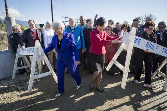 Congress Members Grace Napolitano, left, and Judy Chu at the ceremony for the completion of the bridge. Immediately behind them are Metro Board Chairman Michael D. Antonovich, left, and Metro Board Member John Fasana.