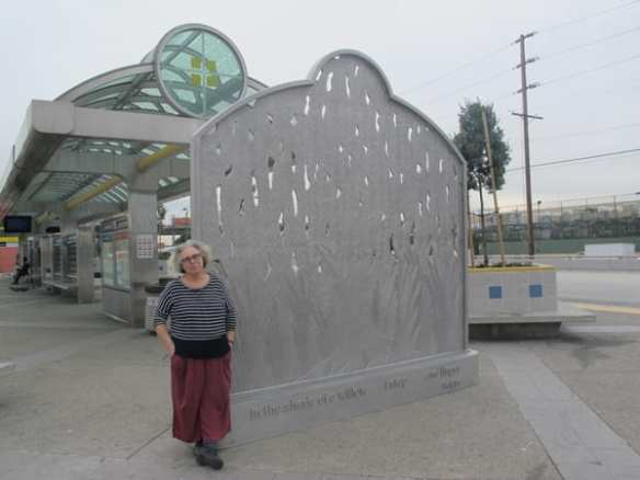 The artist, Alison Saar, after her sculpture has been installed.