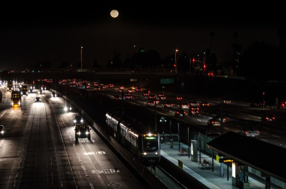 ART OF TRANSIT: A full moon hovers over the Gold Line's Lake Avenue Station in the middle of the 210 freeway in Pasadena. No, I didn't add the moon in Photoshop -- it was there and it was orange-ish. Click above to see larger. Photo by Steve Hymon/Metro.