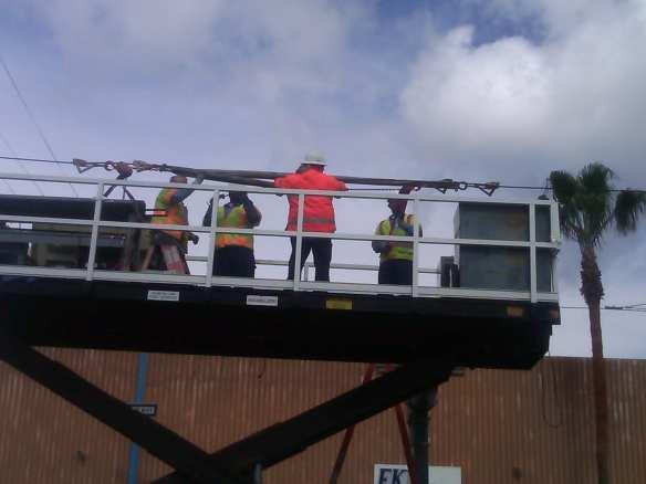 Workers repairing damaged power line.