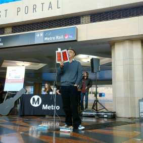 L.A. Times book critic Hector Tobar reading to passing commuters