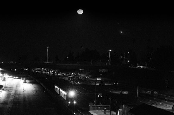 ART OF TRANSIT: It's a full moon on Sunday night, meaning it's time for another Metro Full Moon Photo Challenge.  Get the full moon in a photo with a Metro bus or train and we'll feature it in this space, earning you great amounts of fame on the World Wide Web. Booya! Photo by Steve Hymon/Metro, taken in February from the Lake Avenue bridge over the Gold Line and the 210 freeway.