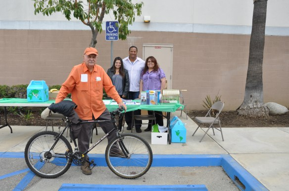 Mr. Baltierra and his bicycle at a City of Commerce rideshare event
