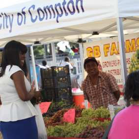 Mayor Aja Brown visits with vendors at the Blue LIine Farmers' Market.
