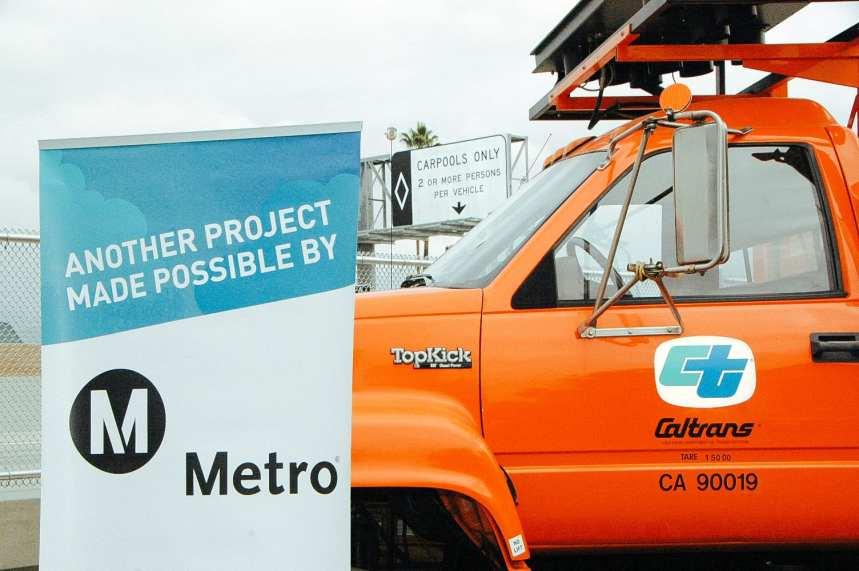 Metro banner meet Caltrans truck, Caltrans truck meet Metro banner.