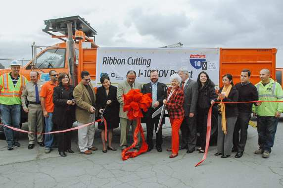 Officials cut the ribbon this morning on the new 4.4 miles of carpool lanes. Congresswoman Grace Napolitano is holding the scissors; Congresswoman Judy Chu is third from left. Photos by Luis Inzunza/Metro.