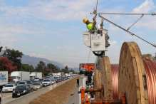 Installing the overhead wires that supply power to trains for the Gold Line Extension in August. Photo: Metro Gold Line Foothill Extension Construction Authority.
