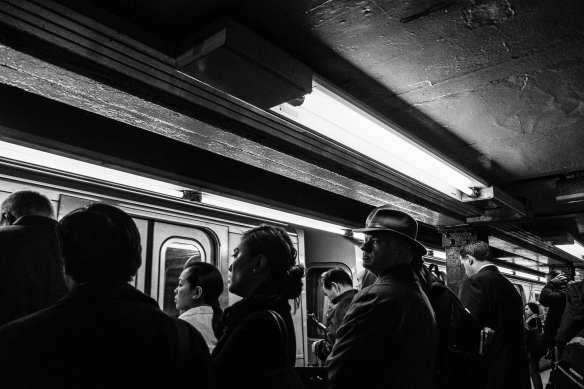 Passengers board the New York subway in September. Photo by Jim Pennucci, via Flickr creative commons.