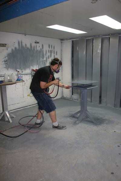 Winsor Fireform technician spraying porcelain enamel on an artwork panel. Photo credit: Winsor Fireform.