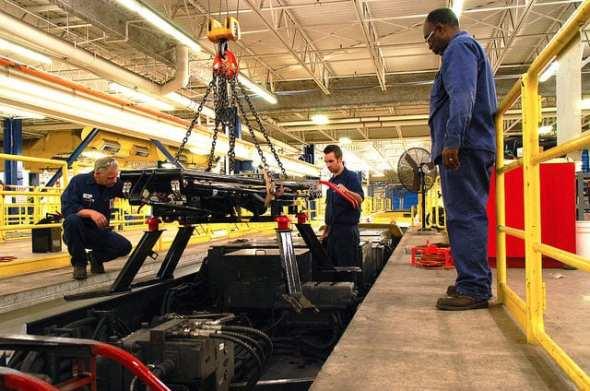 Technicians preparing to install snow-cutter on light-rail vehicle (Photo: Drew Kerr, Metro Transit) via Flickr Creative Commons License