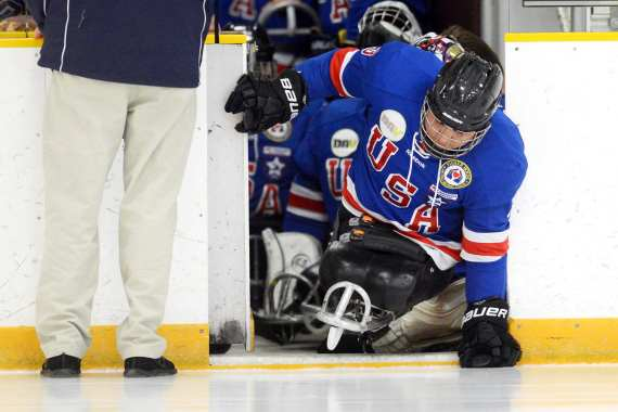 Army veteran Rico Roman handles a puck during a sled hockey game in Rockville, Md., Sept. 18, 2014. Roman was a member of the U.S. National Sled Hockey Team that won the gold medal at the 2014 Paralympics in Sochi, Russia. DoD photo by EJ Hersom.